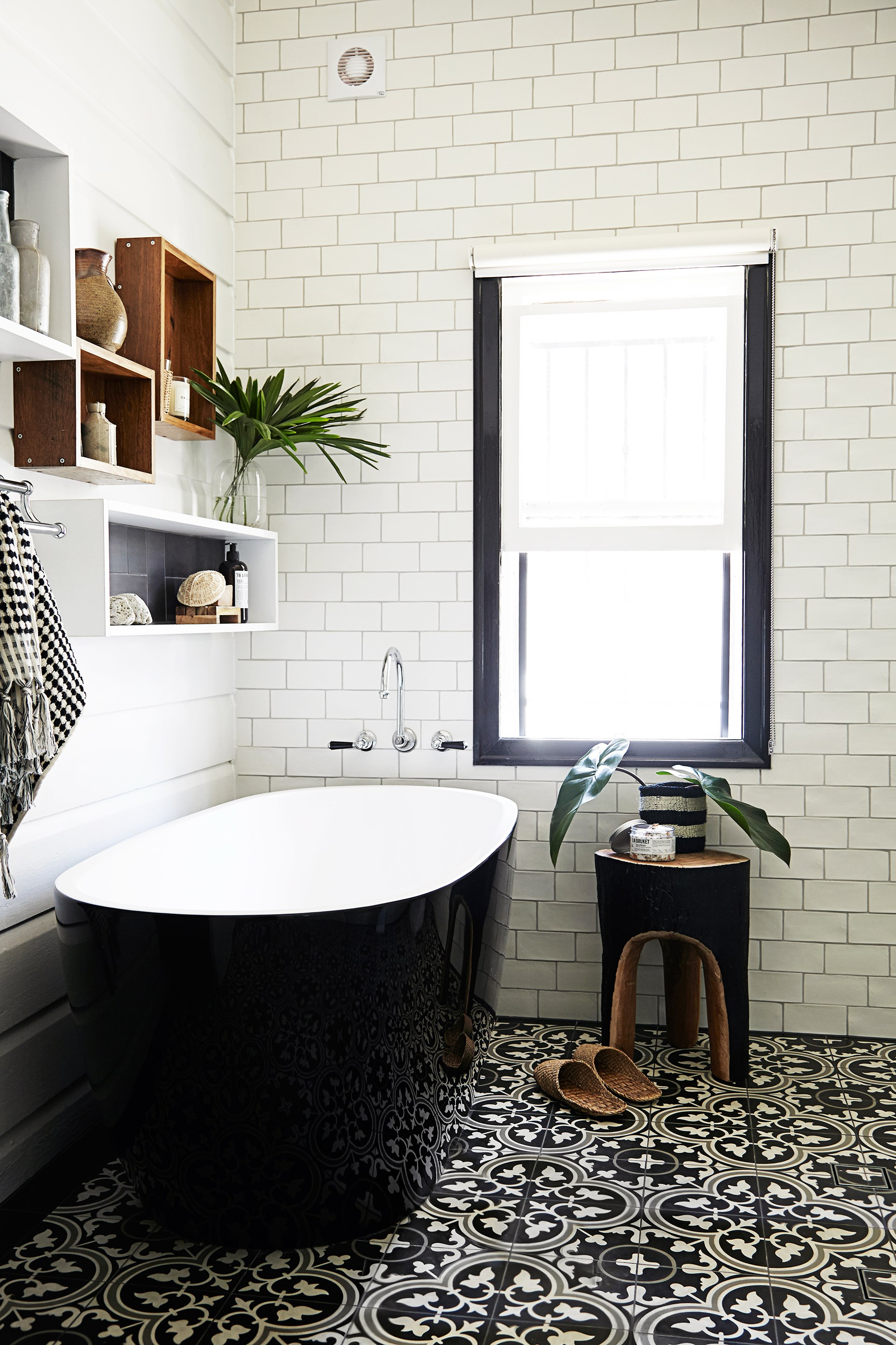 This [eco friendly bathroom](http://www.homestolove.com.au/a-brisbane-cottage-gets-an-eco-bathroom-renovation-1650) celebrates the heritage elements of the home with a modern touch. *Photo: Emma Reilly / Australian House & Garden*