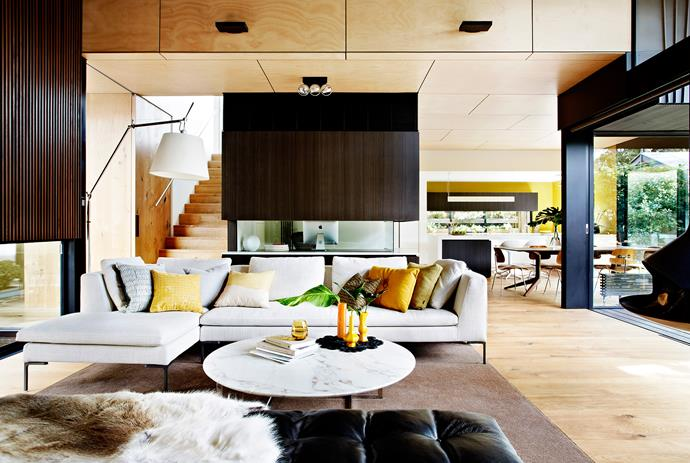 "Hoop pine plywood panelling lines the walls and ceiling of the living area. The flooring is oak.   Tolomeo Mega **floor lamp** from [Artemide](http://www.artemide.com.au/|target=""_blank""). Oro **coffee table** from [Poliform](http://www.poliform.com.au/