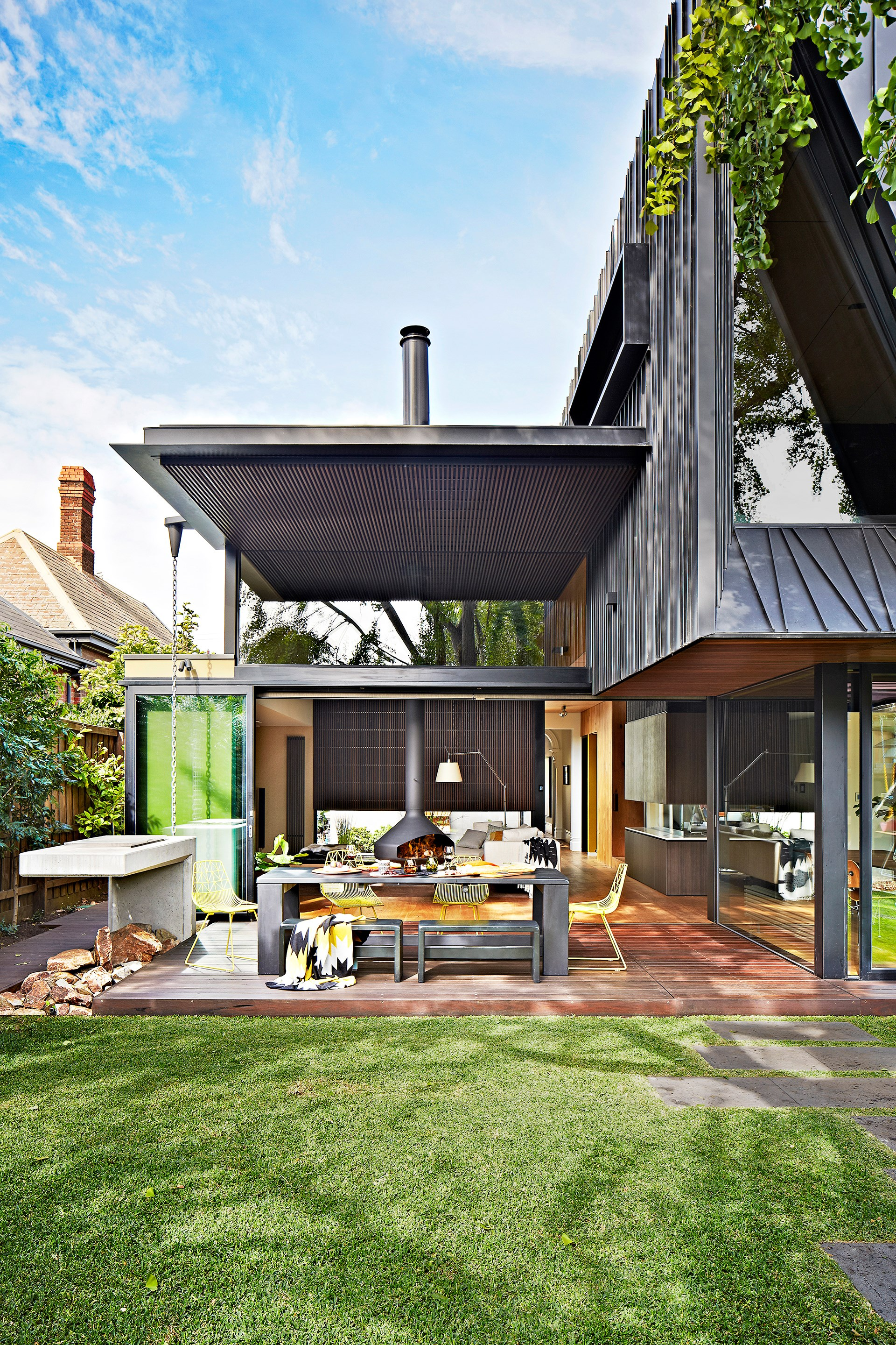 "The back deck is where all the elements of a contemporary [renovation of this Gothic Revival home](http://www.homestolove.com.au/a-contemporary-reno-saves-a-victorian-gothic-home-1656|target=""_blank"") come together seamlessly. *Photo:* Armelle Habib"