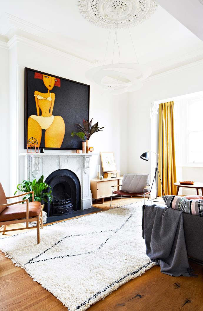 "Now restored, elegant period details take centre stage in the formal living room. The curtains and mantel are original to the house.   Pendant **light** from [Artemide](http://www.artemide.com.au/|target=""_blank""). Lean Light **floor lamp** from [Great Dane Furniture](http://www.greatdanefurniture.com/