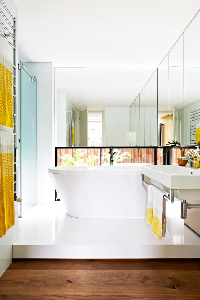 "Wrap around mirrored panels make the compact main bathroom feel larger; the low-set window allows natural light to flood in without compromising privacy.   **Bath** and **basin** from [Rogerseller](http://www.rogerseller.com.au/|target=""_blank"")."