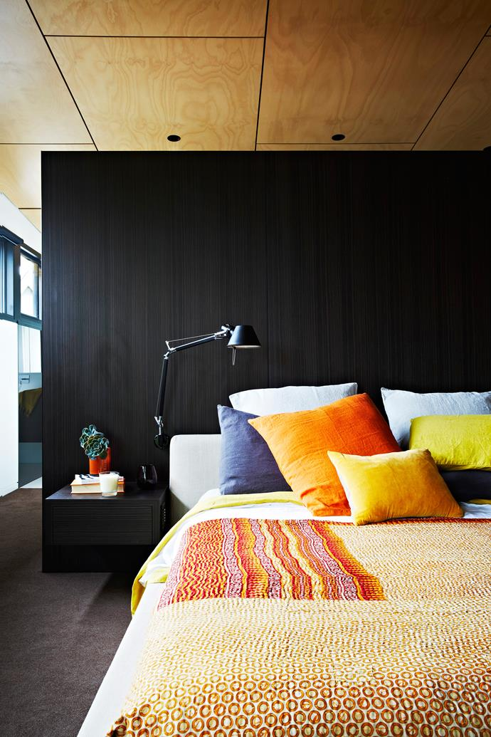 "In the main bedroom, colourful textured bedlinen pops against the Eveneer Aniseed joinery.   Sally Campbell Handmade Textiles **bedcover**, Coté Bastide orange linen **cushion**, and Citta Design yellow velvet **cushion**, all from [Mark Tuckey](http://www.marktuckey.com.au/|target=""_blank""). Tolomeo **wall light** from [Artemide](http://www.artemide.com.au/