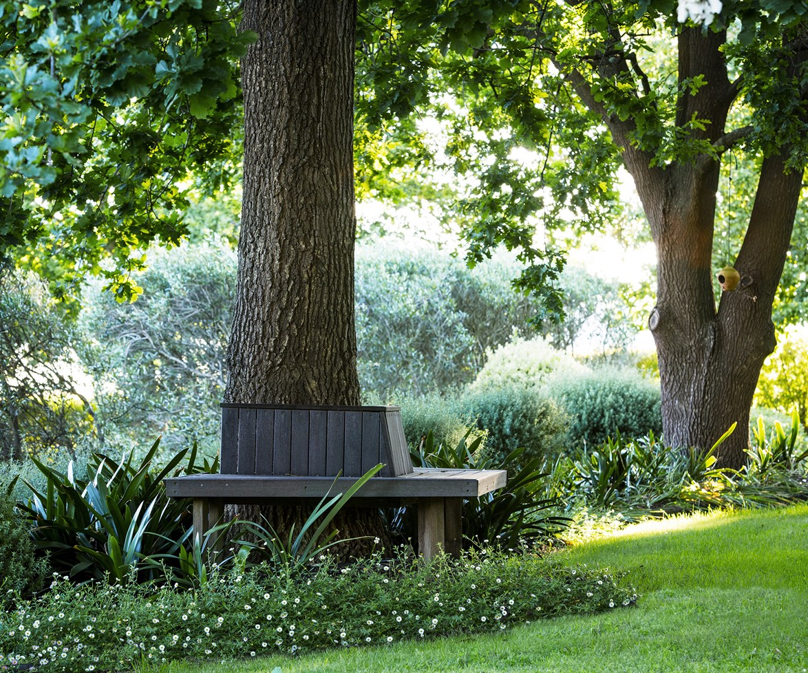 Get lost in the garden with a good book. This bench seat, built around a sturdy oak tree in a [picturesque country garden](http://www.homestolove.com.au/gallery-jennys-picturesque-country-garden-1658), would make the perfect spot! *Photo: Claire Takacs / Australian House & Garden*
