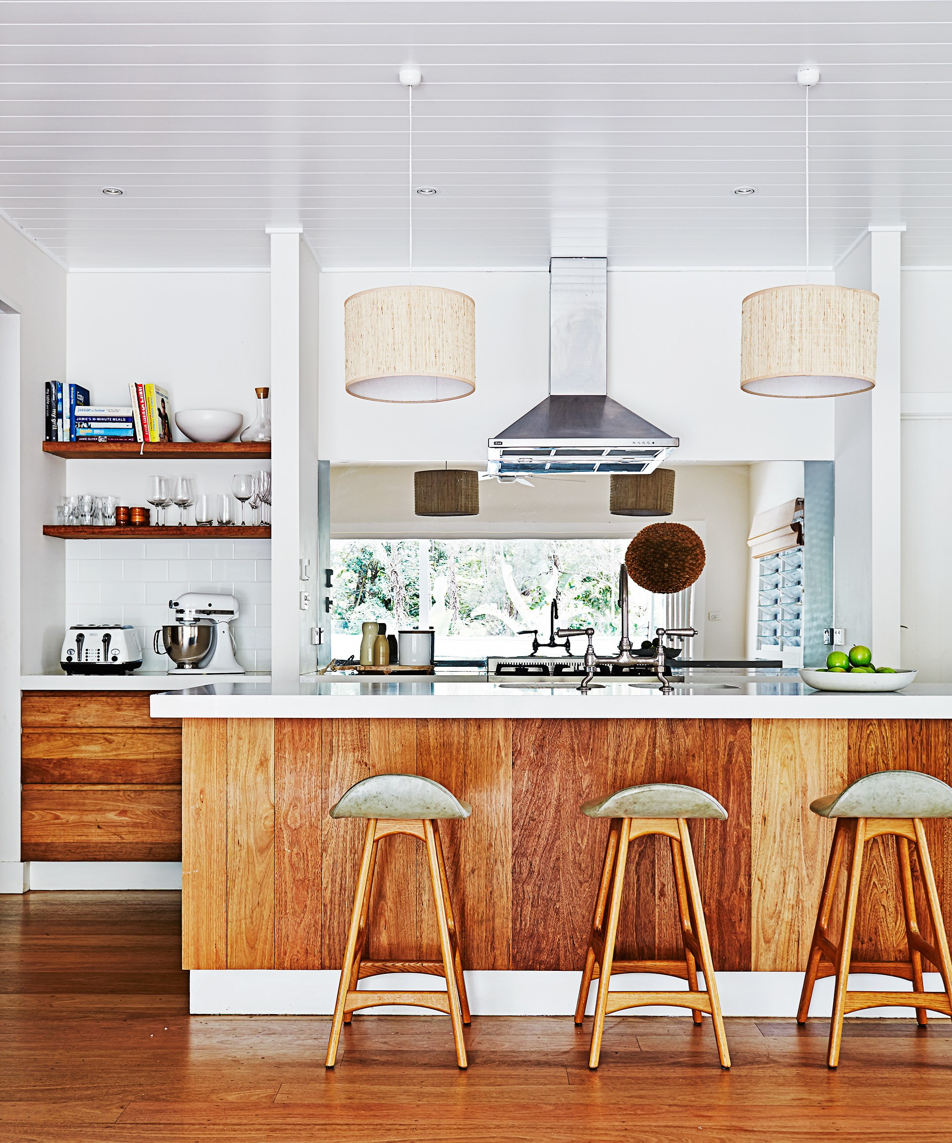 The kitchen in this [backpackers-turned-family home](http://www.homestolove.com.au/gallery-kimberly-and-stephens-byron-bay-beach-house-1660) is decked out in American oak for a warm coastal vibe. The Erik Buch stools from Great Dane Furniture match perfectly!