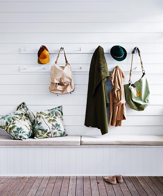 The coat hook is made from deck timber and dowel. Marbau decking was washing down with chlorine to speed up the faded look. Storage contains skateboard, leg ropes, surf wax and camping equipment. Cushion fabric was bought on a trip to Hawaii.