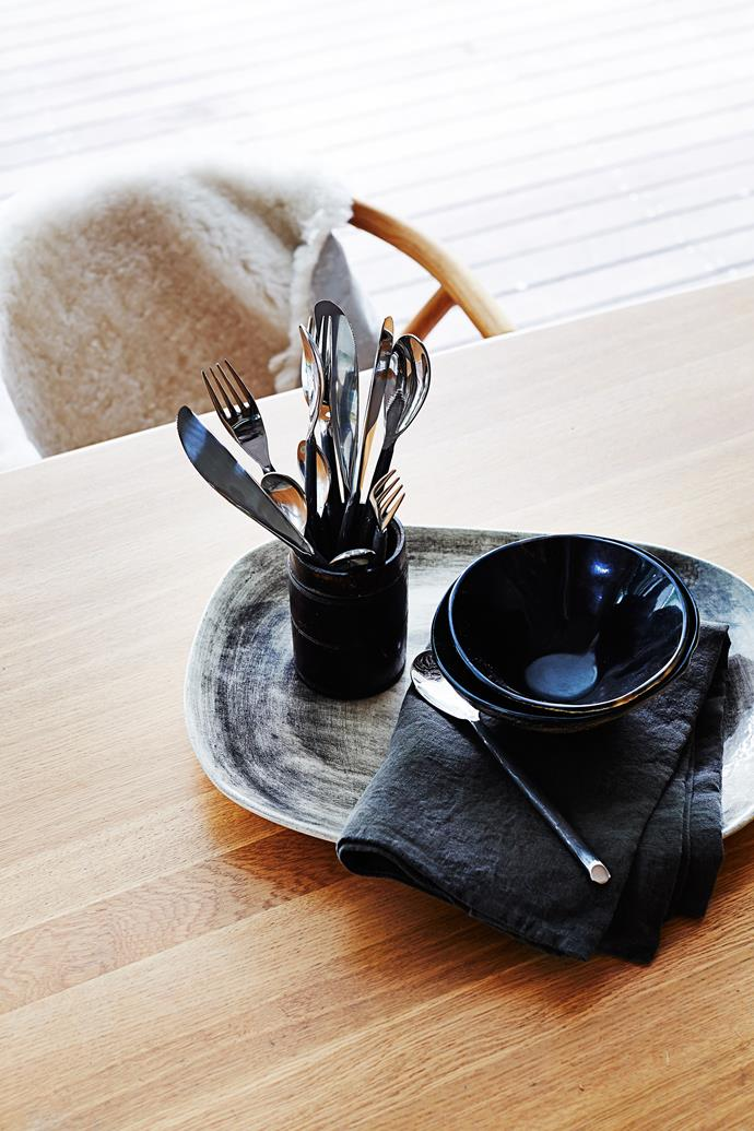 A sheepskin over the back of a chair allows for a super-comfy seating experience. The rustic Wonki Ware platter came from Island Luxe Tribe, Byron Bay.