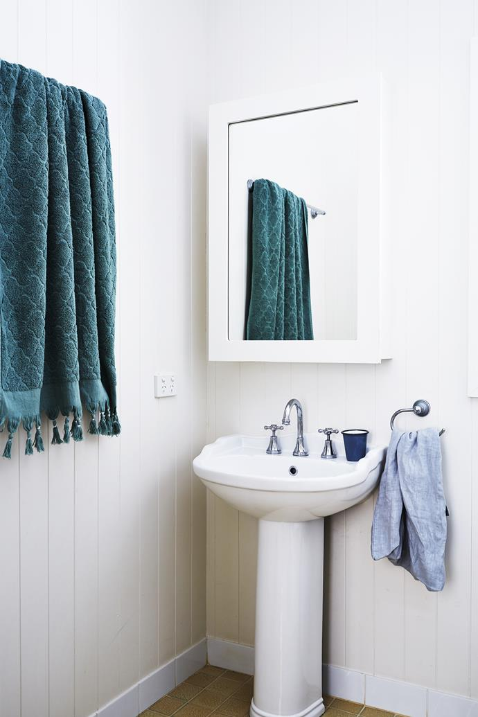 The family bathroom is a pared-back and practical space that can handle anything three boisterous boys might throw at it.