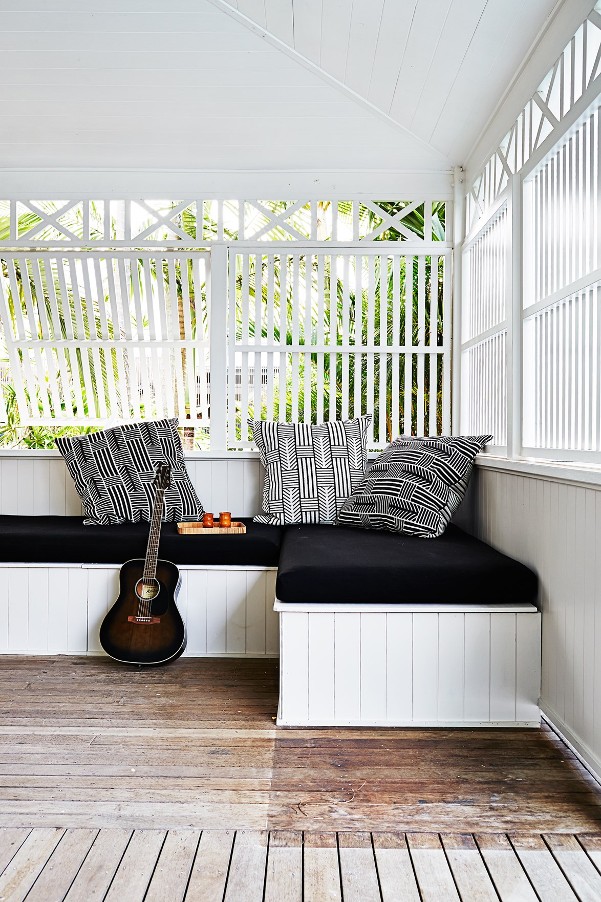 "A built-in daybed on the deck of this [Byron Bay beach house](https://www.homestolove.com.au/gallery-kimberly-and-stephens-byron-bay-beach-house-1660|target=""_blank""), complete with cushions for comfort and slatted shutters for privacy, is ideal for a snooze, or a jam session. *Photo:* Christina Banos"