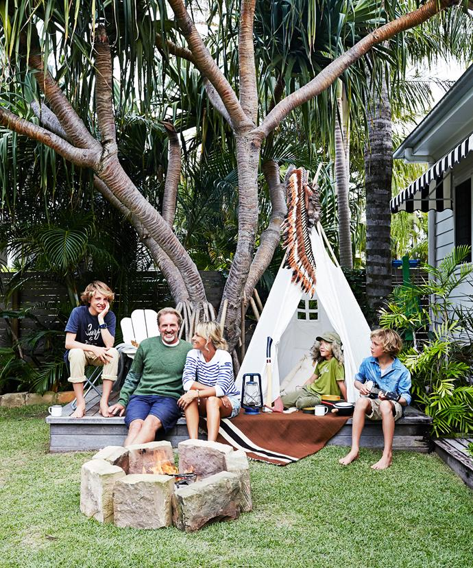 "This family loves to gather and entertain in their backyard, with the stone firepit taking centre stage. See more of their [Byron Bay beach house](http://www.homestolove.com.au/gallery-kimberly-and-stephens-byron-bay-beach-house-1660/?utm_campaign=supplier/|target=""_blank""). Photo: Alicia Taylor / *real living*"