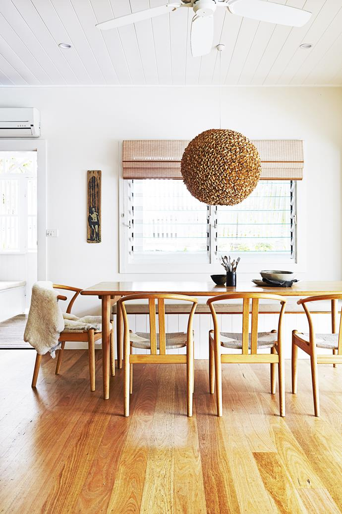 """The pendant light – made from pages from old books – was made by local school kids as part of a project Kimberly was involved in. The JL Moller table came from [Great Dane Furniture](http://www.greatdanefurniture.com/