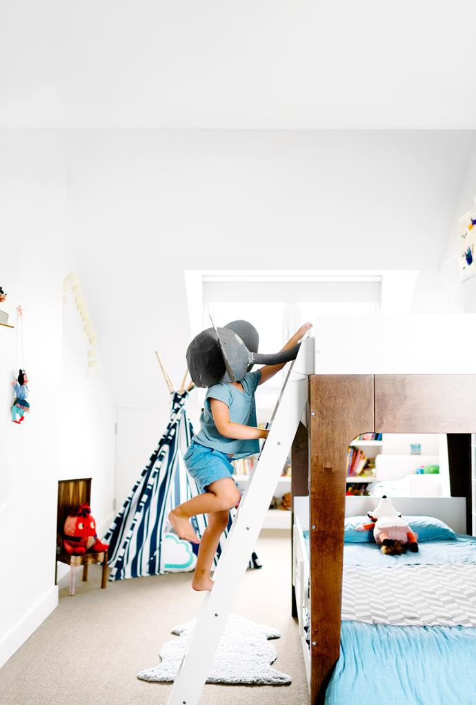 "Four-year-old Harry charges up the bunk ladder in his bedroom. The Humpty Dumpty toy (on chair) belonged to his mother when she was a child.   **Bunk beds** from [Kido Store](http://www.kidostore.com/|target=""_blank""). **Teepee** from [Mediterranean Markets](http://mediterraneanmarkets.com.au/
