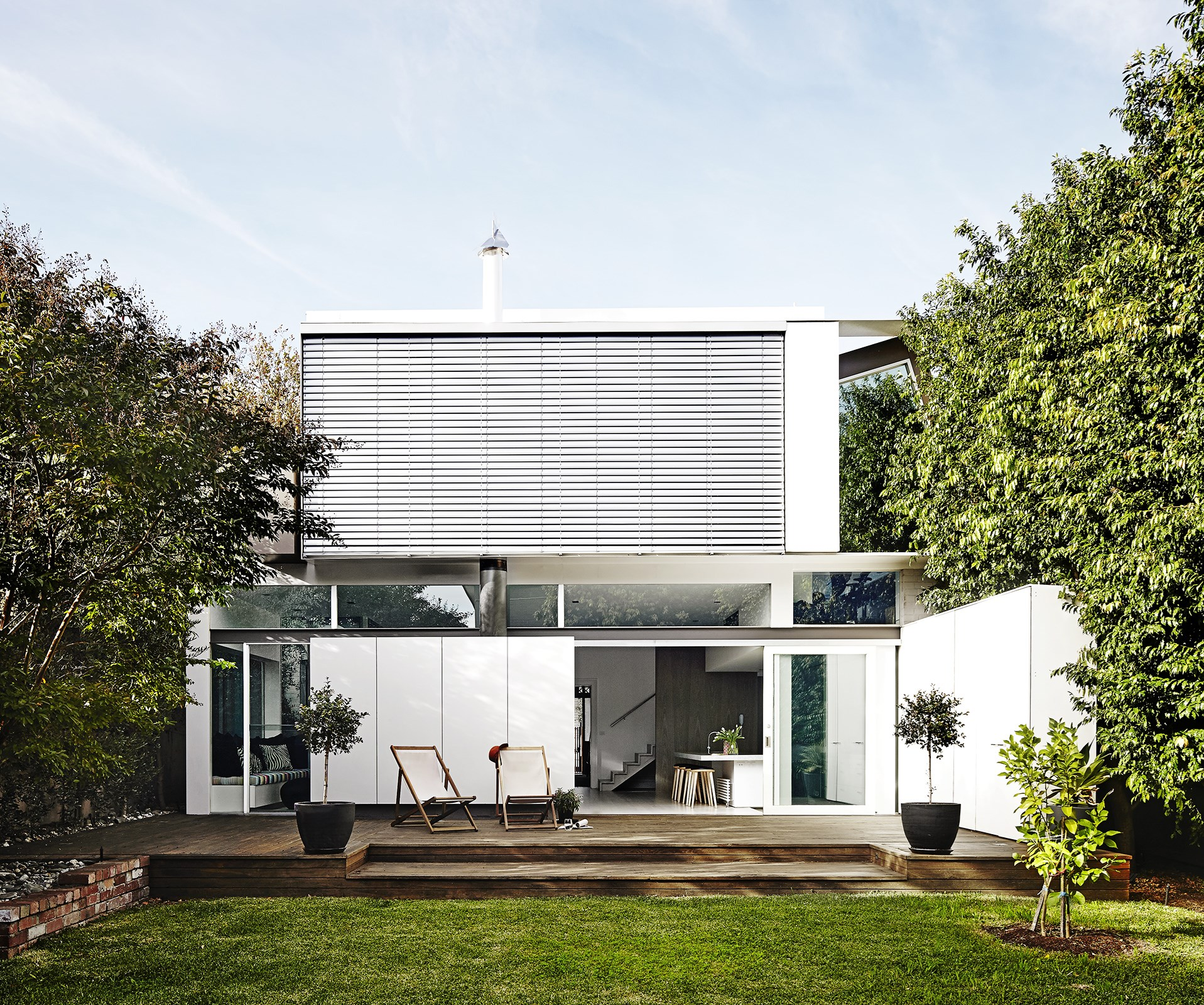 "The deck adjoining this [luxe home in Melbourne](http://www.homestolove.com.au/gallery-vivienne-and-maxs-luxe-hotel-inspired-home-1671|target=""_blank"") is minimally furnished to suit the contemporary exterior. *Photo:* Sharyn Cairns"