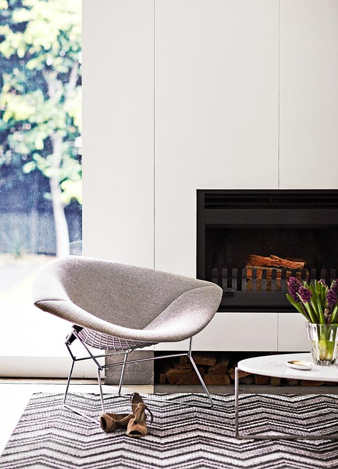 "Asked what she wanted to achieve, Sally says: ""Calm and sophisticated, relaxed elegance with a little bit of bling"". The Harry Bertoia Diamond chair in front of the fireplace is from [Dedece](http://www.dedece.com/