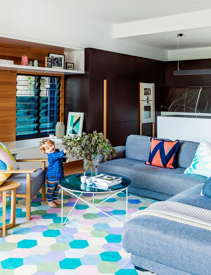 """""""We live on the lower level, with the living room and outdoor area acting as one whole room,"""" says Kim Bridle, the owner of this renovated weatherboard home in Brisbane. Powder-coated aluminium louvres carry breezes throughout the house in summer, while skylights draw in light all year round."""