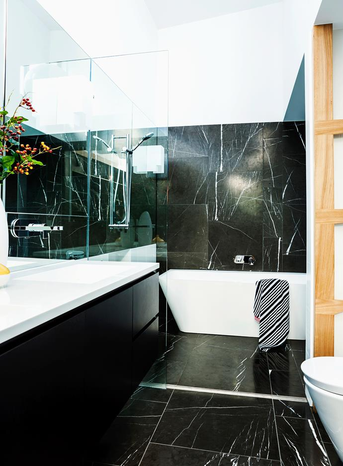"""Black-stained oak veneer, dark marble and white Corian form a study in contrasts in the bathroom. The Casa Lusso bath is from [Harvey Norman Commercial](http://www.harveynormancommercial.com.au/