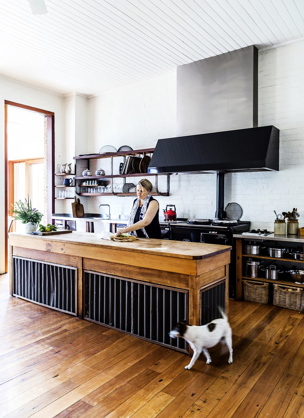"To give the French provincial look an Australian slant, try adding corrugated iron. In this [schoolhouse turned family home](https://www.homestolove.com.au/gallery-vals-converted-schoolhouse-in-the-country-1676|target=""_blank""), the kitchen has all the makings of a French home (exposed shelving, a mammoth range-hood and fire-burning stove, as well as a generous timber island) but feels contemporary with accents of black. *Photo: Maree Homer / Story: Australian House & Garden*"