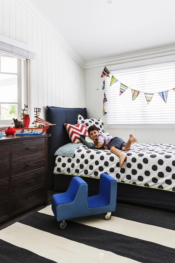 "Rather than a full-blown nautical theme, Finn's room has managed to evoke the spirit of the high seas with bunting and an ornamental boat, allowing for changing tastes with the coming years in this [Brisbane family home](http://www.homestolove.com.au/gallery-lori-and-sanjays-relaxed-brisbane-queenslander-1679/?utm_campaign=supplier/|target=""_blank""). Photo: Maree Homer"
