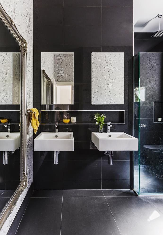 Pops of yellow balance the cool neutrals of the luxurious ensuite bathroom, complete with a rain shower, which was completed by the previous owner.