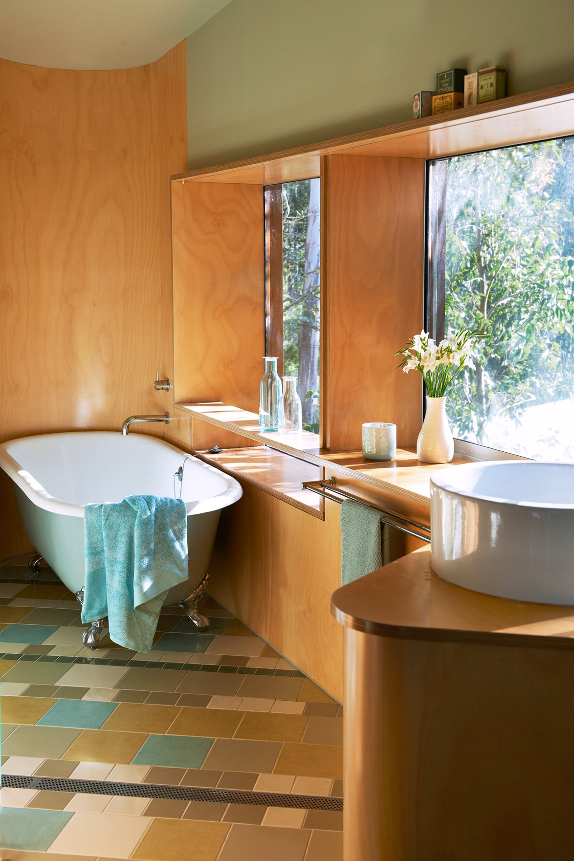 "Eucalyptus greens and rich timbers form the basis of this contemporary country bathroom at a [1960s renovated beach house](https://www.homestolove.com.au/gallery-janes-1960s-style-beach-house-renovation-1690|target=""_blank""). Every room in the home maintains a strong sense of connection to the bush and beach nearby. *Photo: Brigid Arnott / Styling: Lisa Hilton / Story: Australian House & Garden*"