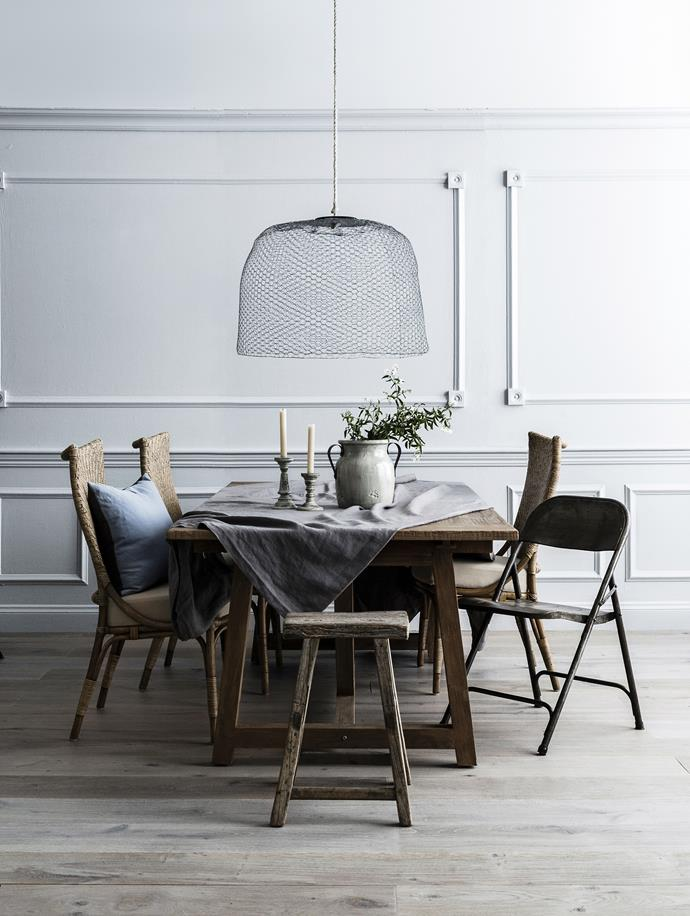 "**Mix and match:** A traditional backdrop brings elegance to an eclectic dining setting.   Un Esprit en Plus giant wire mesh cloche (used as **pendant light**) from [Honeybee Homewares](http://honeybeehomewares.com.au|target=""_blank""). Melody rattan **dining chairs** with polyester seat cushions, and Sika Design Lucas aged teak **dining table**, both from [Domo](http://www.domo.com.au