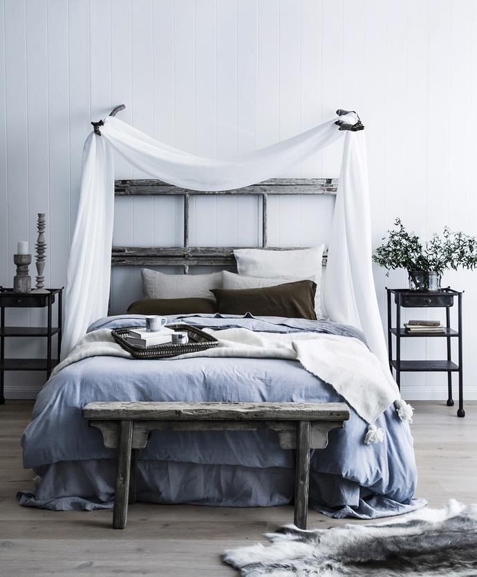 "**Higher purpose:** Old French doors take on a new lease of life when repurposed as a bedhead. Juxtapose greyed-off wood with tactile textiles, changing hues with the seasons.   **Canopy** in Corfu polyester fabric from [Warrick Fabrics](https://www.warwick.com.au/|target=""_blank""). **Bedhead** made from French timber doors from [Maison et Jardin](http://www.maisonetjardin.com.au