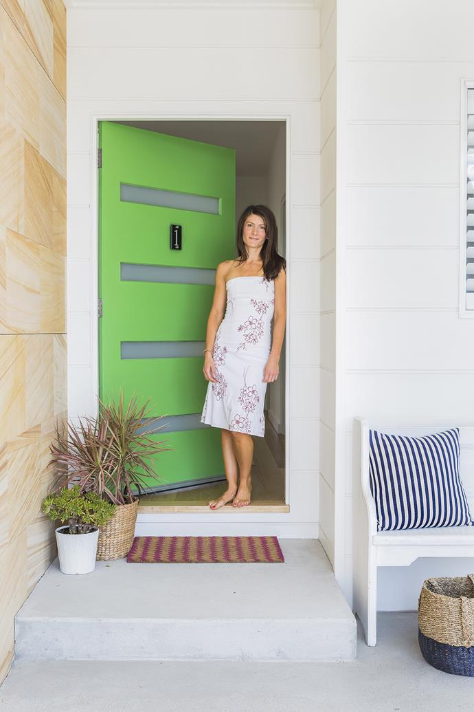 The subtle concrete, sandstone and white shades of the Miller family home are lifted to a new level by the brightly-painted mint green door at the entrance.