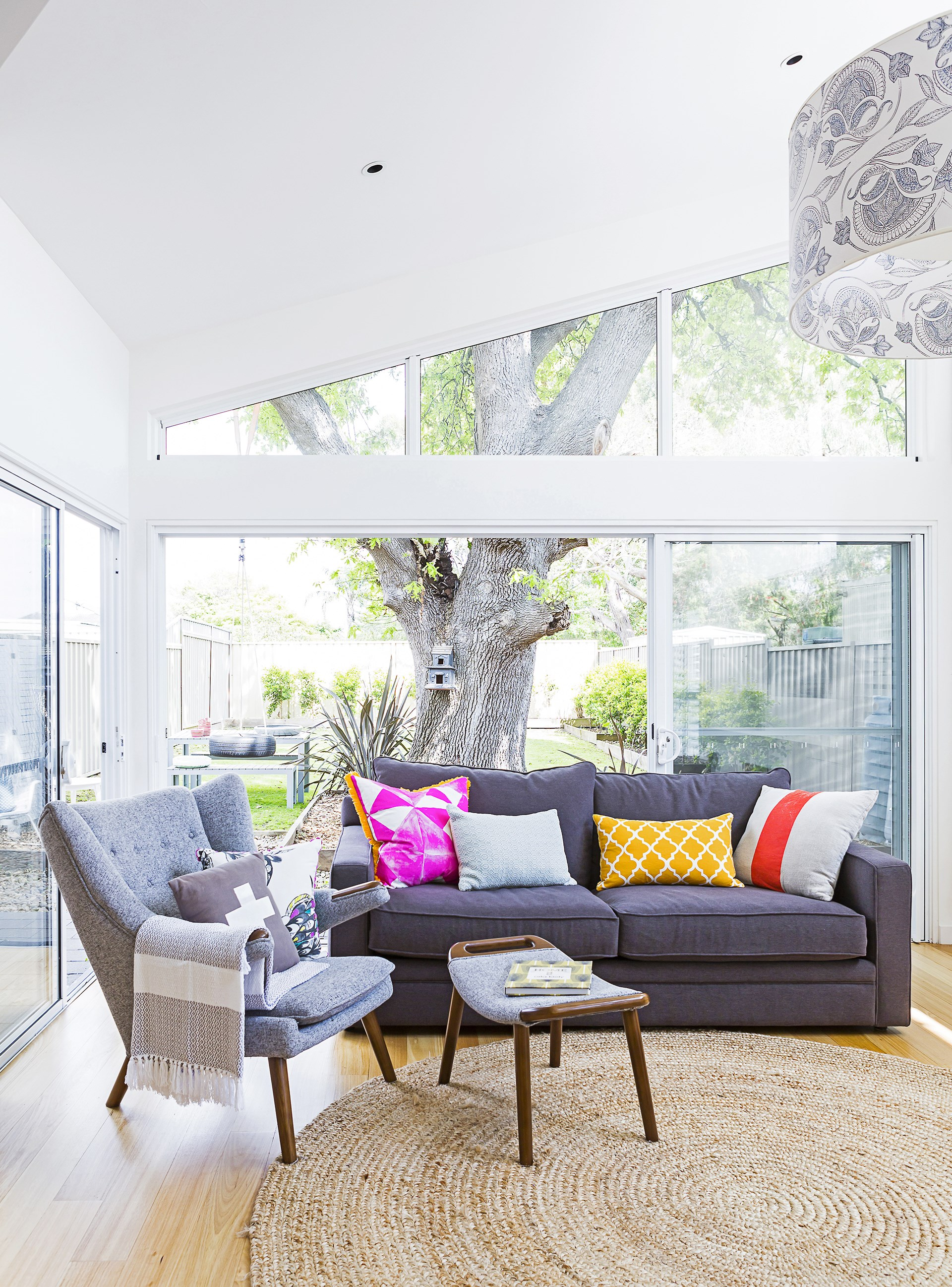 """This light and bright living room in a new Melbourne house can be opened right up to let the summer breezes inside, but also welcomes the northern sun in winter through transom windows - it's pleasant no matter what the temperature. [Take the tour](http://www.homestolove.com.au/gallery-finishing-touches-for-a-new-family-home-1709