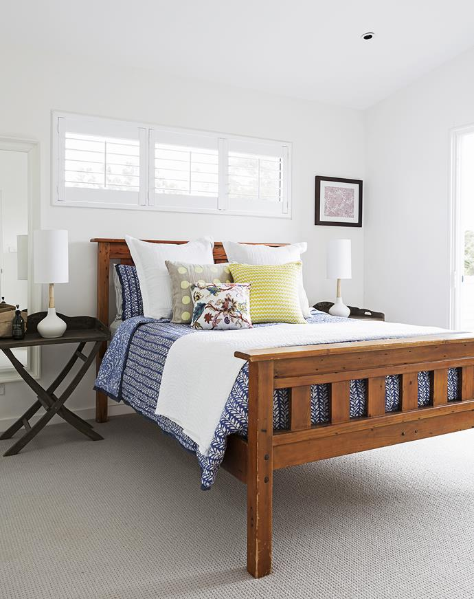 Wool carpets bring warmth and comfort to the couple's own bedroom, while plantation shutters add character.