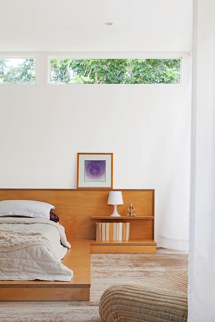 """The 4.2m-wide, hoop pine plywood platform bed and side table unit was also created by Noek. """"Everything in the house is kept low and large in proportions,"""" he says."""