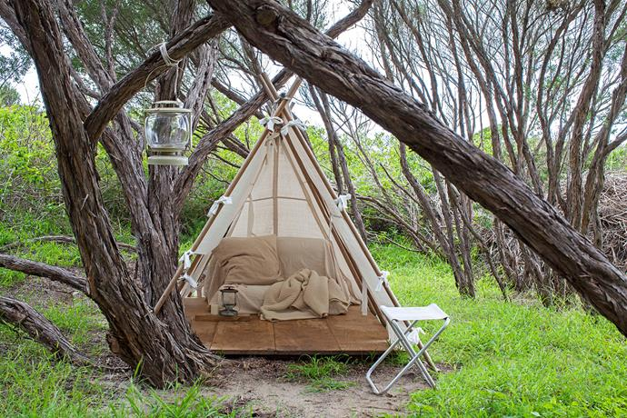Diana's meditation tent sits in a circle of tea trees. She sewed drip sheets together; these were waxed to avoid deterioration. Hoop pine plywood flooring and Tassie oak dowels, tied together with rope, complete the build.
