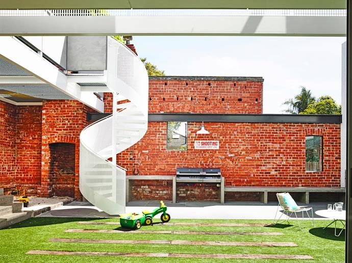 """An outdoor fireplace and pizza oven enhance the potential for casual alfresco entertaining. Recycled red gum sleepers are set into artificial turf from [Ausgrass](http://www.mysyntheticgrass.com.au/ target=""""_blank"""")."""