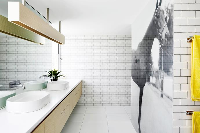 """A print of racehorse Kazoo adorns a glass panel that screens the toilet.   [Corian](http://casf.com.au/ target=""""_blank"""") **vanity top** in Antarctica. Little 65 **basin** from [Paco Jaanson](http://pacojaanson.com.au/ target=""""_blank"""")."""