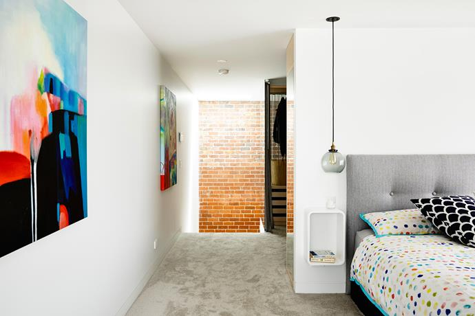 """""""We used the red bricks we salvaged during demolition to form the double-height void with staircase leading up to the main bedroom,"""" Kara says.   **Bedlinen** from [Target](http://www.target.com.au/ target=""""_blank"""")."""