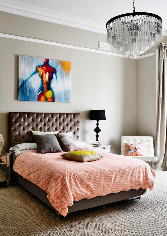 """Art brings vivid colour to the guest room's classic interior, while an Odeon chandelier from [Restoration Hardware](https://www.restorationhardware.com/ target=""""_blank"""") injects elegance.   **Bedhead** from [Cafe Lighting & Living](http://www.cafelighting.com.au/ target=""""_blank""""). **Bedside tables** from [Dare Gallery](http://www.daregallery.com.au/ target=""""_blank""""). **Quilt cover** from [Cotton On](http://cottonon.com/AU/ target=""""_blank"""")."""
