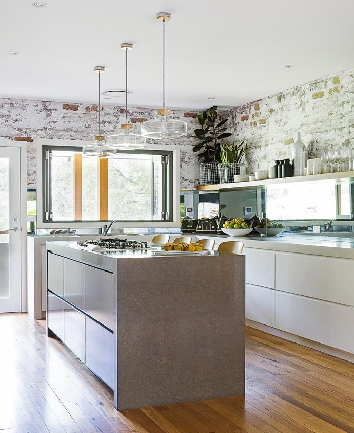 Let there be light! Mirrored splashbacks reflect even more light into the bright open-plan kitchen.