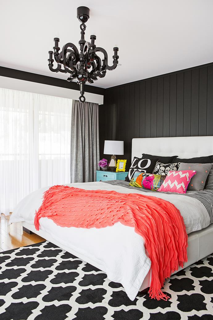 """Dramatic black-and-white finishes and bright accessories rule this room, which is """"sporting a touch of glamour!"""" Amy says."""