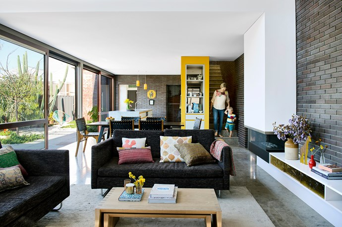 """Imogen, with her son Henry, loves the dimensions of the living room space, the light and the connection to the garden.   **Sofas** and **dining chairs** from [Empire Homewares](http://www.worldofempire.com/