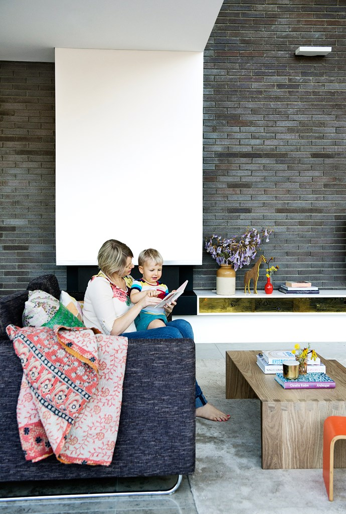 """The dark bricks in the spacious living area are a nod to the 70s houses in the area. """"We think they're really cool,"""" says Imogen."""
