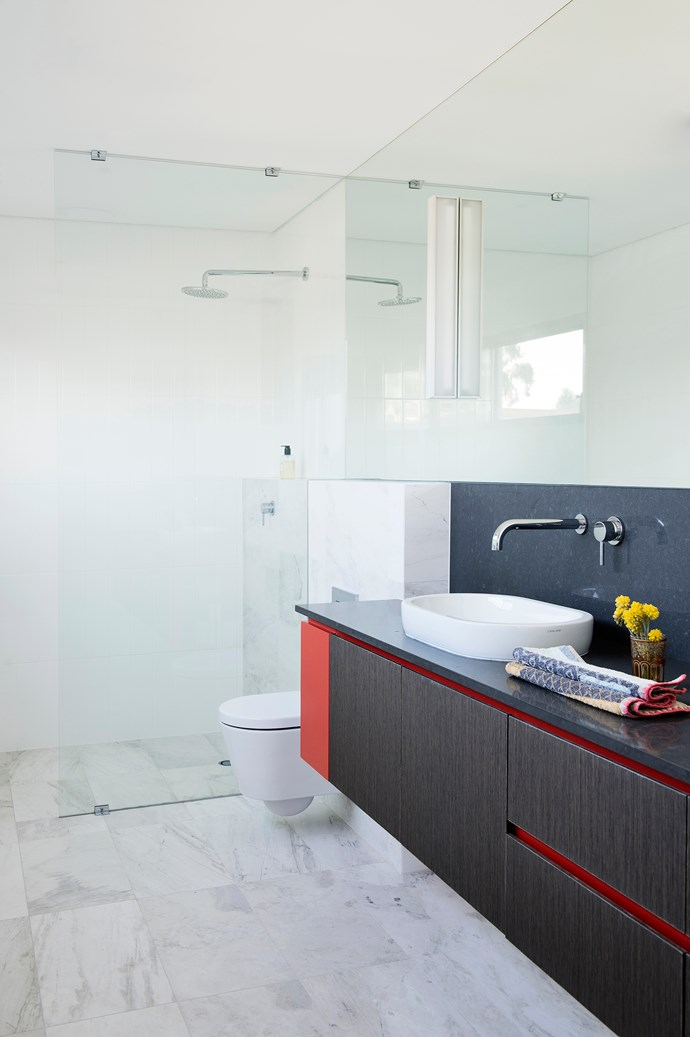 """A shelf on the rear wall of the shower does away with the need for caddies.   **Benchtop** and **splashback** in [Caesarstone](http://www.caesarstone.com.au/