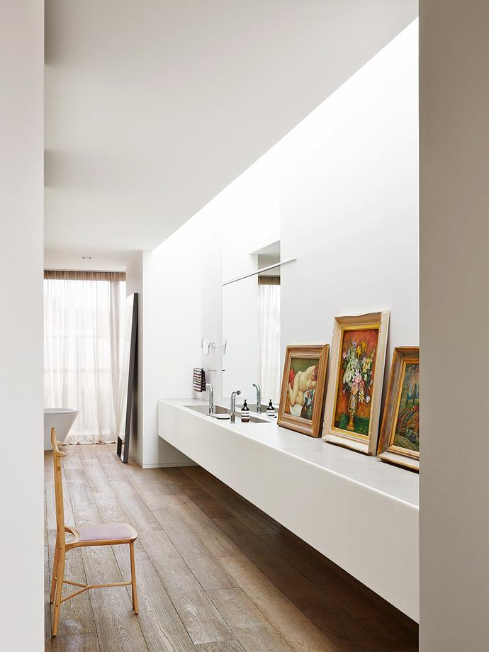 "Possessing countless artworks and treasured objets d'art, the client was adamant that the design accommodate their display wherever possible. ""Steel shelves in the kitchen, sliding screens, timber ledges and even the extended marble vanity in the ensuite all provide opportunities for an evolving display of art and objects,"" says Stephen."