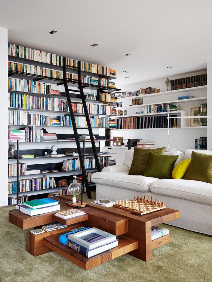 "The architect created a blackened steel library tower to function as the homes spine to honour her request that her books were front and centre. ""It was so important that we decided to make it a very strong yet simple gesture,"" says Stephen.   A Roderick Vos for [Linteloo](http://linteloo.com/