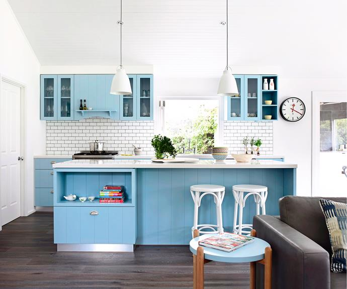 White subway tiles are great for splashbacks while pendant lights add some instant 'wow factor' to living spaces.  **Caution!** While we think this blue kitchen is a breath of fresh air, it might not be every buyer's cup of tea. Photo: Derek Swalwell / bauersyndication.com.au