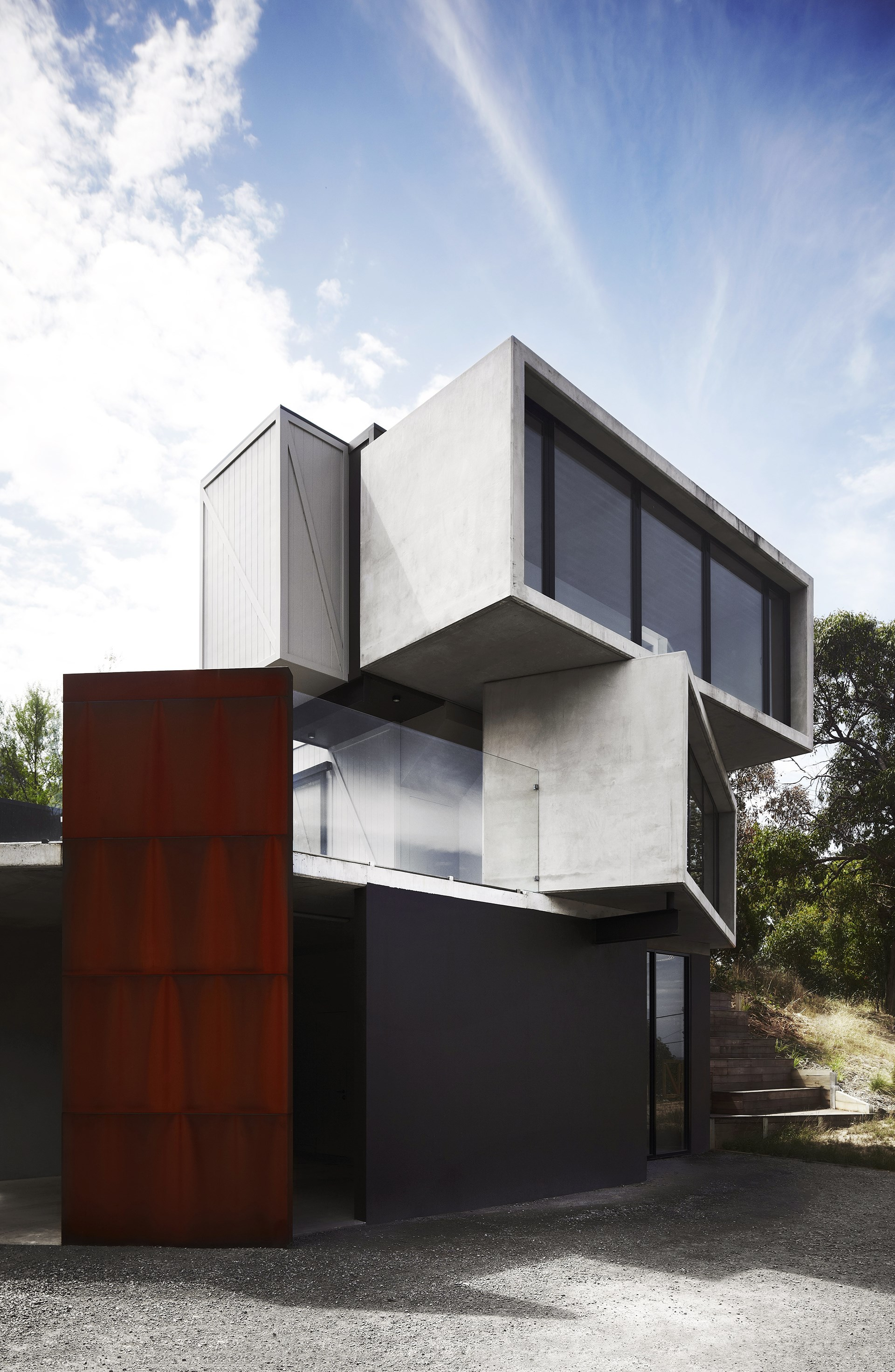 To create the appearance of randomly stacked containers, two 20-tonne concrete boxes were trucked along the Great Ocean Road and then craned into position. Find out more about this [concrete and steel pod house in Lorne](http://www.homestolove.com.au/concrete-and-steel-pod-house-in-lorne-1762). Photo: Sharyn Cairns / *Belle*