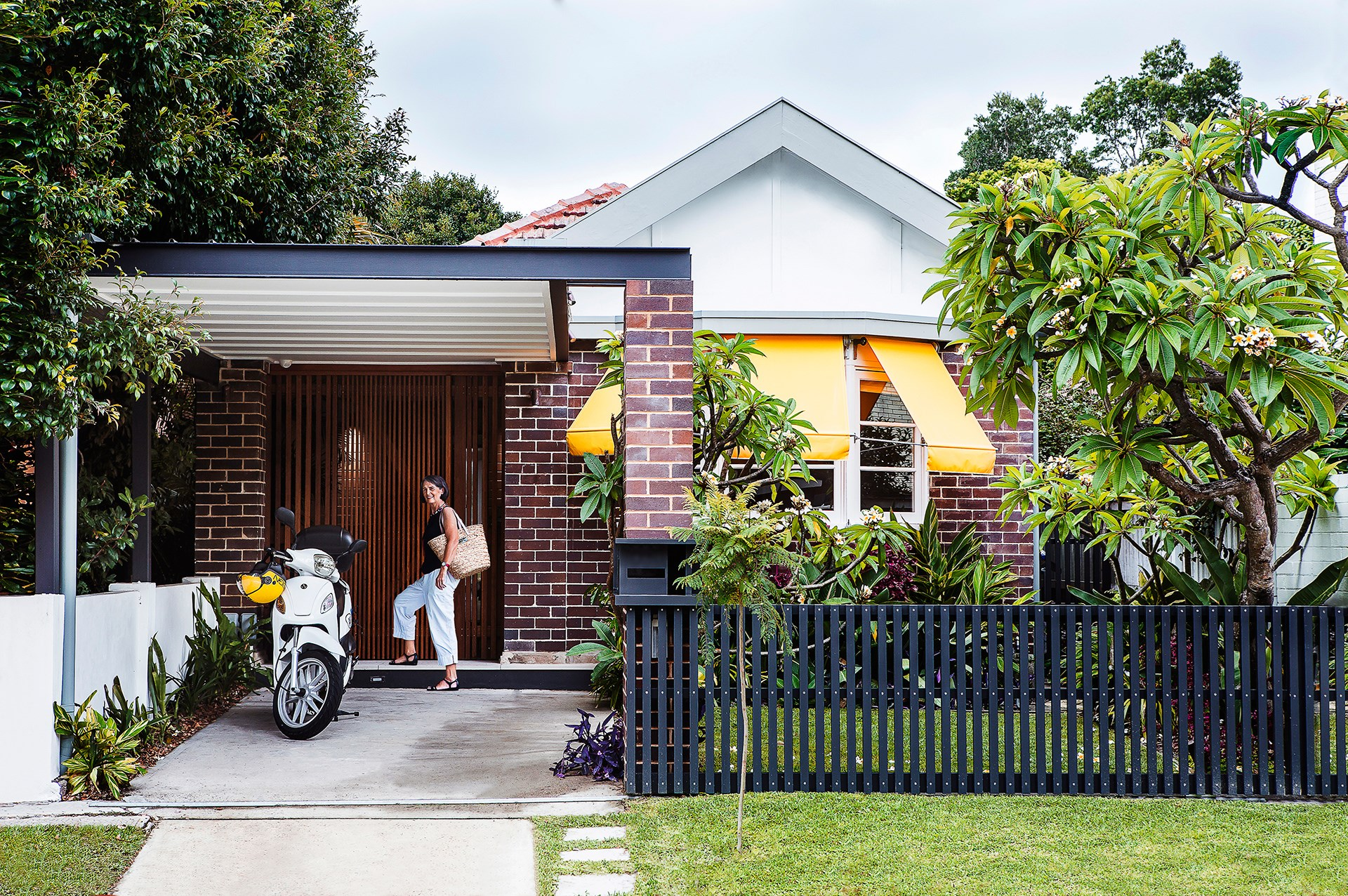 This neat and tidy traditional facade belies the ultra-modern renovation that lies within. Find out more about [eco friendly downsizing exercise](http://www.homestolove.com.au/gallery-dianne-and-davids-small-house-design-makes-a-big-impact-1765). Photo: Maree Homer / *Australian House & Garden*