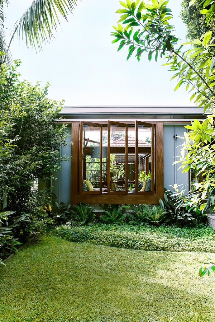 """The rear courtyard, located between the family room and the studio pavilions, has a beautifully landscaped garden that offers yet more verdant views.   **Landscaping** by Mark Paul from [The Greenwall Company](http://www.greenwall.com.au/