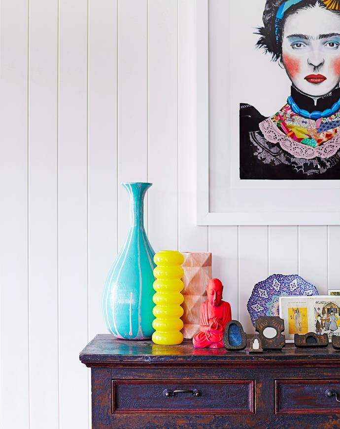 The selection of objects on this sideboard avoids being cluttered due to the variation in heights and the way they reflect the colours in the print above. Photo: Alicia Taylor / bauersyndication.com.au