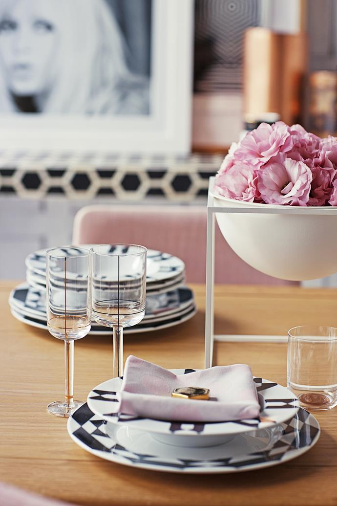 """Crystal glassware isn't the only way to evoke a ladylike sensibility. Simple clean lines and metallic detailing and floral accents bring a table setting to life.   Larsson **dining table** in Oak Natural from [Freedom](http://www.freedom.com.au/