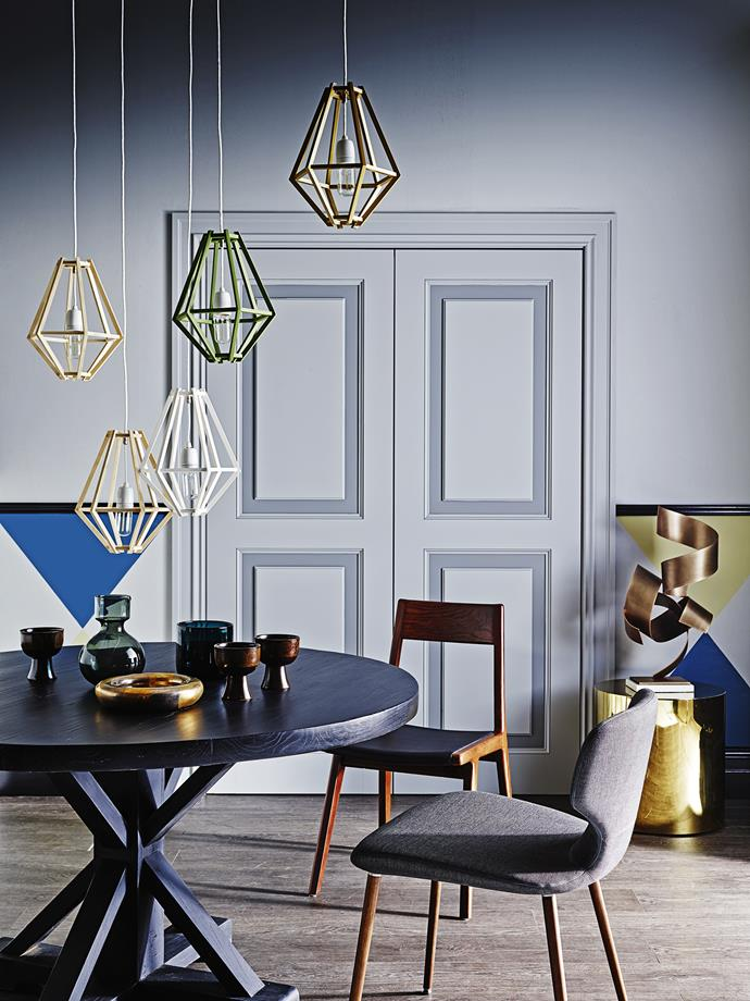 "Think about how you use your dining room before lighting it. Will it also act as an office space? If so, you'll need to light for multiple purposes.   260 Cumulus **pendant lights** in Natural and Painted Ply from [Enoki](http://www.enoki.com.au/?utm_campaign=supplier/|target=""_blank""). Bruges **dining table** in Slate from [MCM House](http://www.mcmhouse.com/?utm_campaign=supplier/