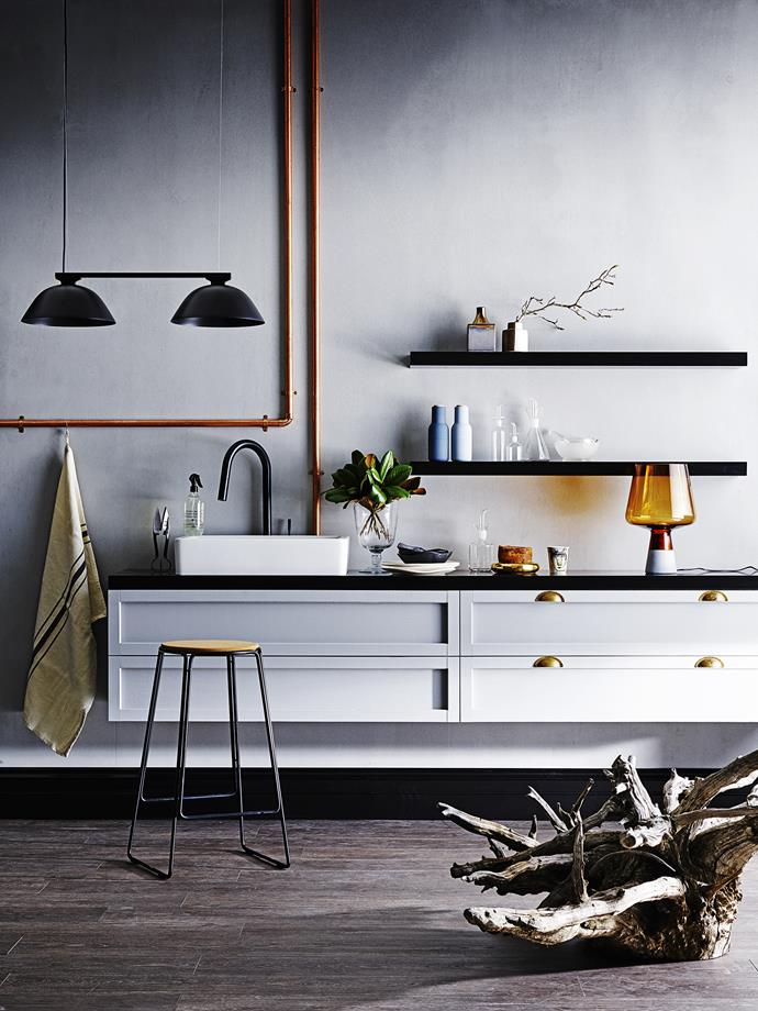 "It seems obvious but ensure you light areas of the kitchen where you'll be working. Think practicality first before going all out with pendants and stylish additions.  Wästberg Sempé two-shade **pendant light** in Deep Black from [Euroluce](http://euroluce.com.au/?utm_campaign=supplier/|target=""_blank""). Iittala Leimu table lamp, and Smed stool from [Great Dane Furniture](http://www.greatdanefurniture.com/?utm_campaign=supplier/