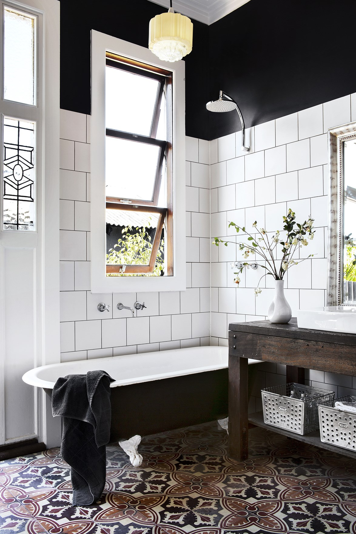 "You could be forgiven for thinking that this is a restored bathroom in a heritage home, but it's actually a [new build created from recycled and re-purposed materials](https://www.homestolove.com.au/gallery-carla-and-bens-art-deco-style-new-house-1798|target=""_blank""). A mix of modern and vintage pieces give the home it's country meets art-deco flair. *Photo: Angelita Bonetti / Styling: Kate Nixon / Story: Australian House & Garden*"